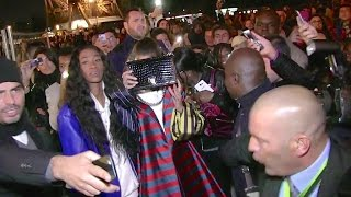 rihanna finally makes it out of the eiffel tower protected by the police through a sea of fans