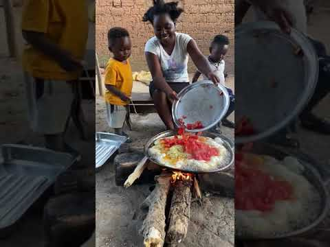 Beautiful african woman cooking
