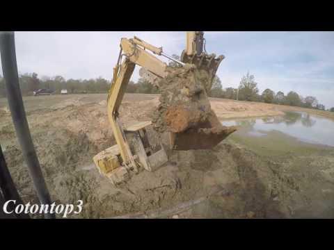 Caterpillar excavator sunk in a pond
