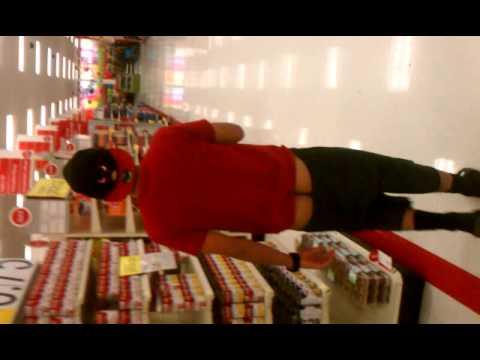 Awkward man walks with his pants down at target