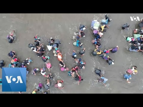 Drone Images of Migrants Crossing into Mexico Through River