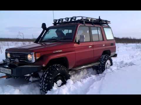 Лапокрузер выковыривает снегоход