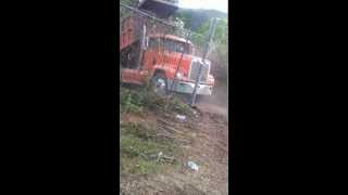 Skilled Dump Truck Driver Dumping Material