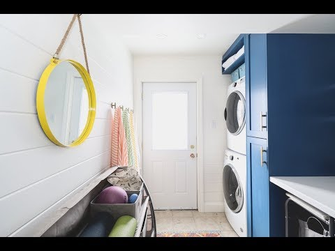A colorful and organized laundry room for a family of four