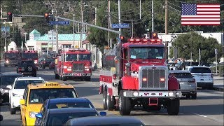 Huge convoys of fire trucks responding blasting horn and siren