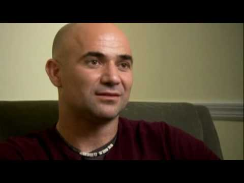 Andre Agassi signs copies of autobiography ' Open' for fans