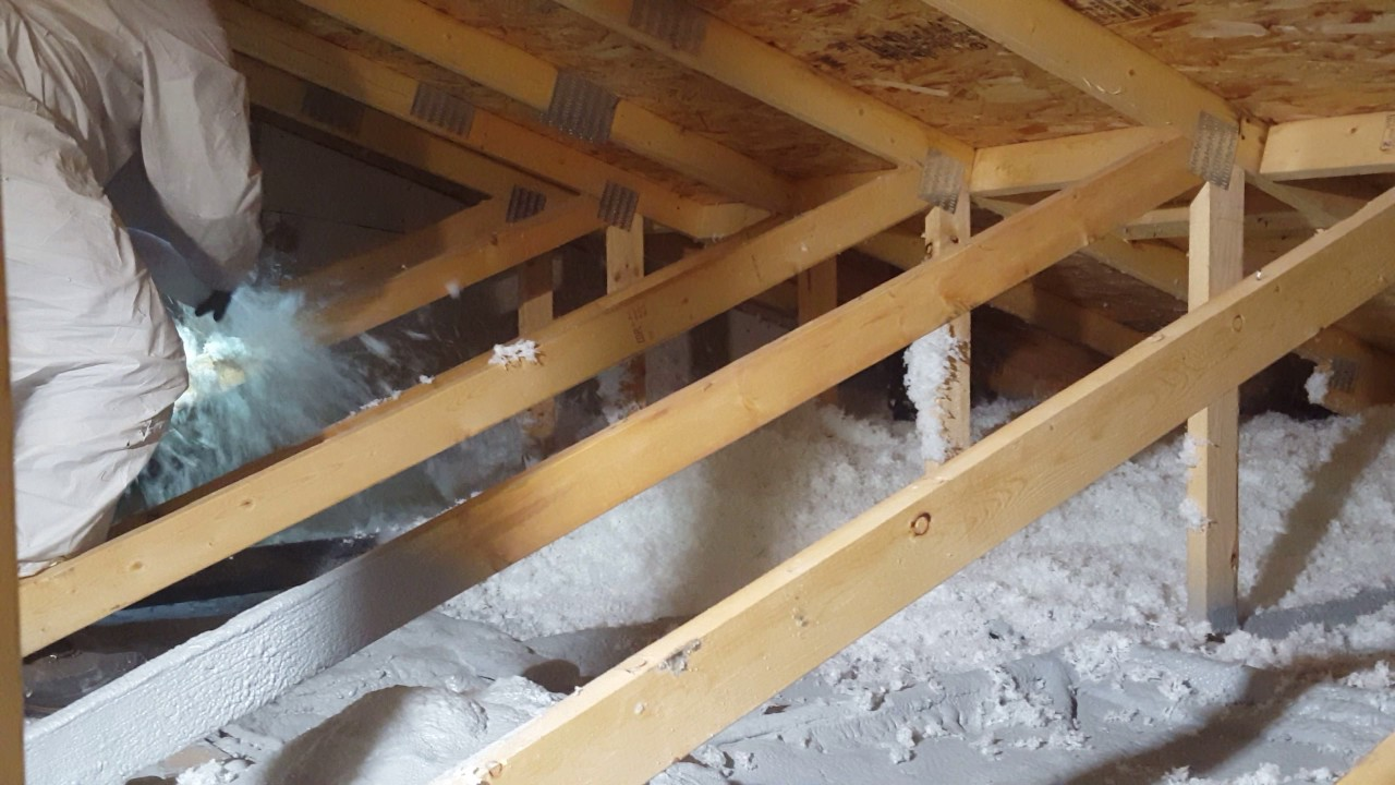 Attic insulation blown in loose fill aztec spray for Loose fill insulation r value