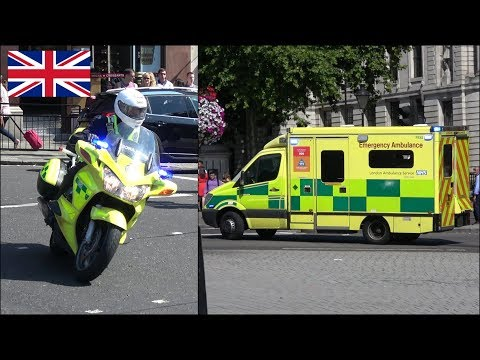 London Ambulance and motorcycles responding with siren and lights