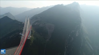 LIVE: Driving above clouds! Why build world's highest bridge in mountains of SW China