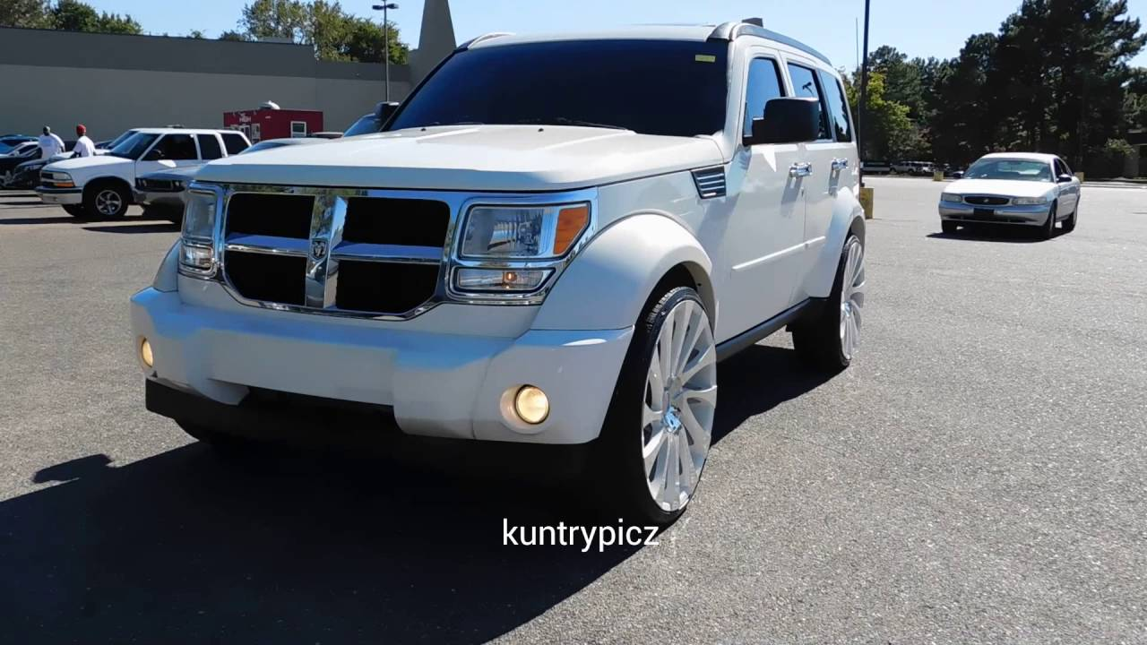 White dodge nitro on starr wheels - YouTube
