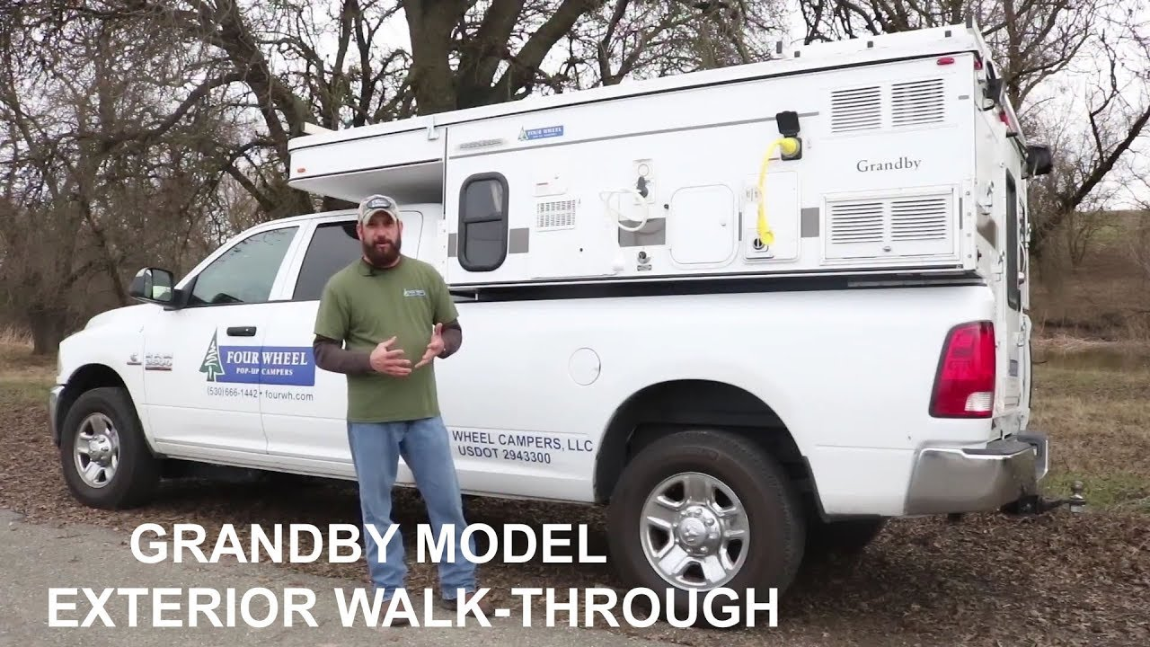 Four Wheel Campers' Granby Exterior Pop-up Truck Camper Walk-through