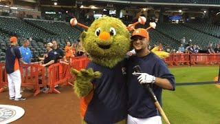 Houston Astros mascot Orbit promotes his birthday during BP
