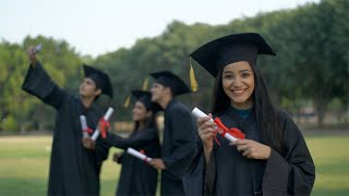 Young graduated girl holding her graduation degree in pride - convocation ceremony