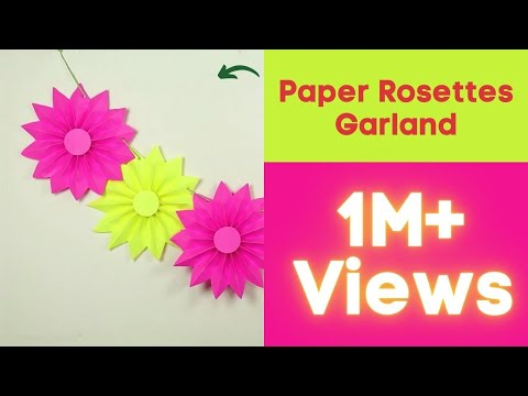 Diy paper rosettes garland for simple party decorations on for Decoration paper