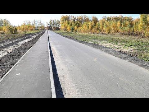 Глава Луховиц осмотрел новые тротуары и плотину Репинского пруда