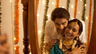 Reflection of South Indian couple in the mirror - smiling and getting ready for festival celebration