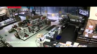 CCTV footage of armed robbers breaking into a store