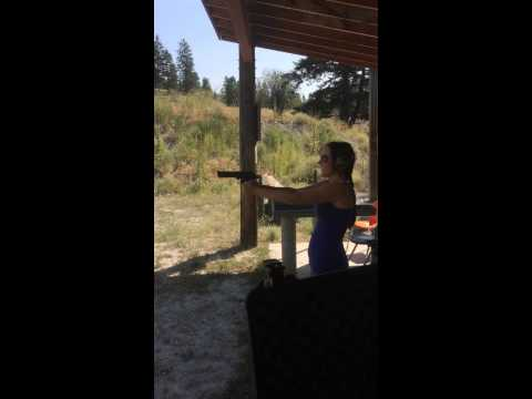 Young woman shooting .44 MAG Desert Eagle without  hitting absolutely anything.