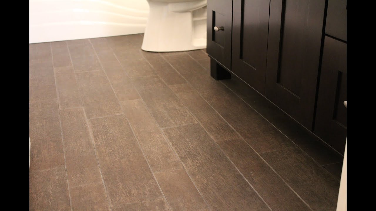 Installing tile that looks like hardwood youtube for Hardwood floor in bathroom