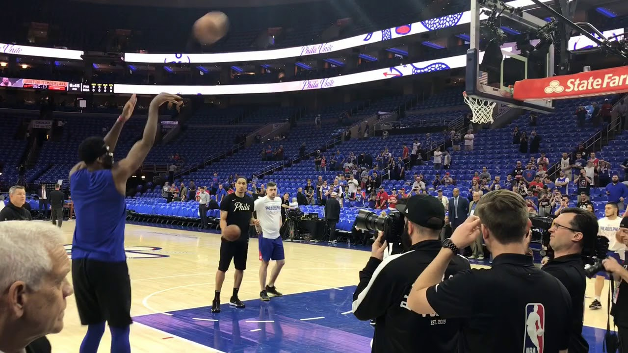 Masked Joel Embiid shooting before Sixers playoff game