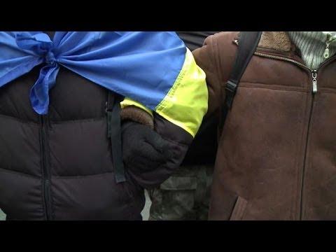 Ukraine opposition keeps up protest despite PM warning