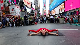 Nina Burri performs Contortion Act - Imagine - on Times Square in NYC
