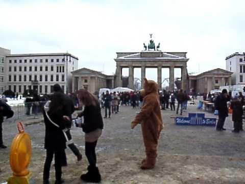 Bear Man hugs Berlin tourist girls