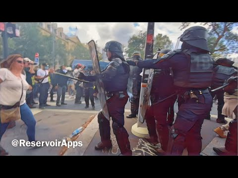 Police overwhelmed by anti-Macron protesters in Paris
