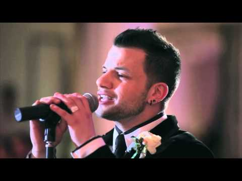 Groom suprises his beautiful bride by serenading her -