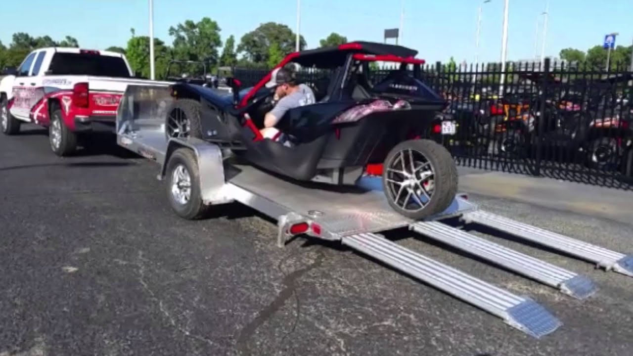 how to get to the battery in polaris slingshoy