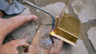 A skilled worker is brazing the metal