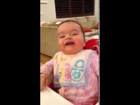 Baby discovers her nose for the first time