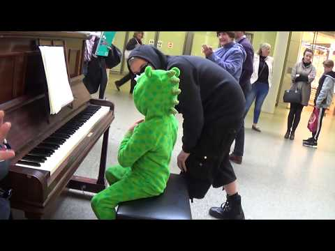Baby Dinosaur's First Street Piano Lesson