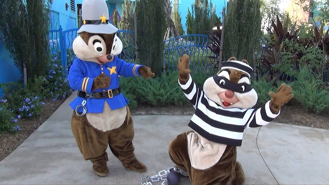 chip and dale in cop and bandit halloween costumes at disney's art