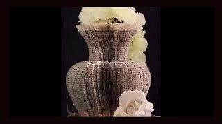 Book folding. Cut a stunning vase from a book. Easy done in less than an hour.