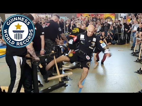 Most baseball bats broken with shins in one minute - Guinness World Records