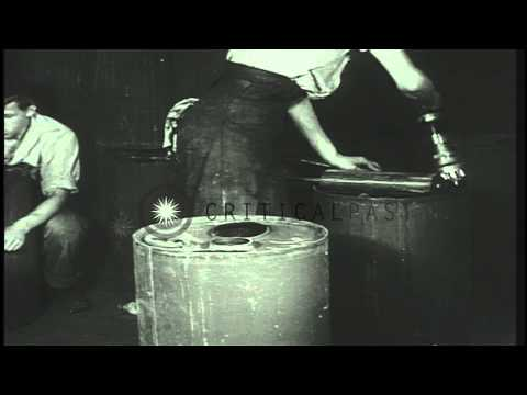 Depth charges being manufactured and used in Canada during World War II. HD Stock Footage