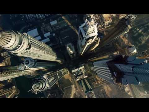 Amazing wing suit flying between Dubai marina towers