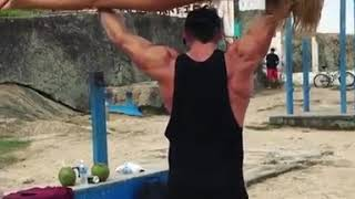 Strong guy lifting his girlfriend to workout