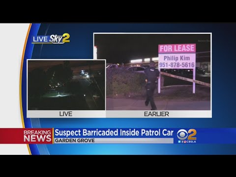 Suspect Barricaded In Garden Grove Police Vehicle With Access To Officer's AR-15, Shots Fired