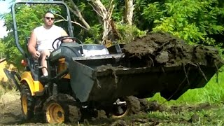 Diy 4x4 Diesel Powered Tractor Excavating In The Mud And Dirt