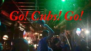 Fans sing Go! Cubs! Go! after winning the World Series in a Los Angeles bar