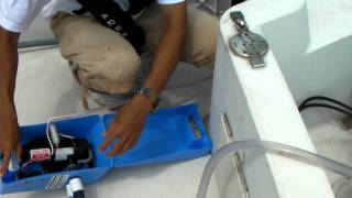 海上係留の船外機洗浄方法