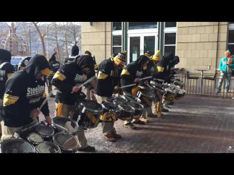Steelers drum line revs up freezing fans for playoff game