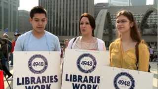 Three Library Workers at Toronto Public Library Workers Union Rally at City Hall