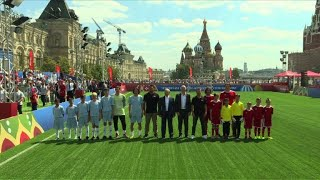 Putin, Infantino kick off football tournament for orphans