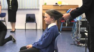 Brave girl cuts her locks for charity
