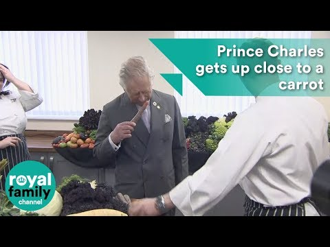 Prince Charles gets up close and personal with a carrot at factory visit