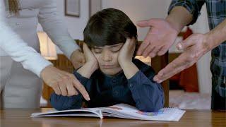 Indian parents scolding young boy for his studies - Parenting, parental pressure, stressed child, school homework