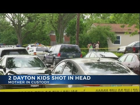 Mother in custody after 2 children found shot in front of Dayton home